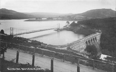 A temporary road bridge was erected across Burrator Reservoir during reconstruction of the dam.
