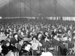 The audience at one of the shows or military band concerts in the Hoe Summer Theatre on Plymouth Hoe